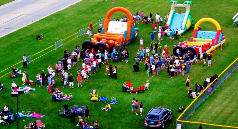 People & Inflatables At A Company Picnic