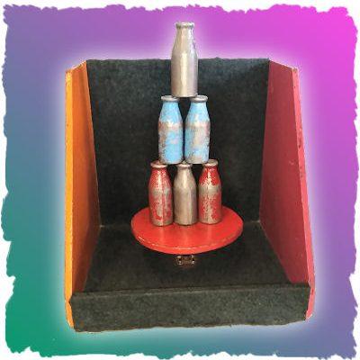carnival-game-milk-bottle-knock-down_eb067788b236e044b668ef46f6179176
