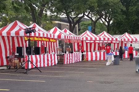 Carnival Food Stations At A Company Picnic